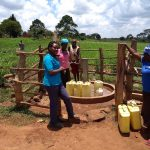 The Water Project: Byebega-Kirisa Community -  Field Officer Olive Chatting With The Community Members