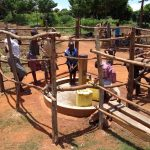 The Water Project: Maiha-Kayanja Community -  Community Members Using The Water Point