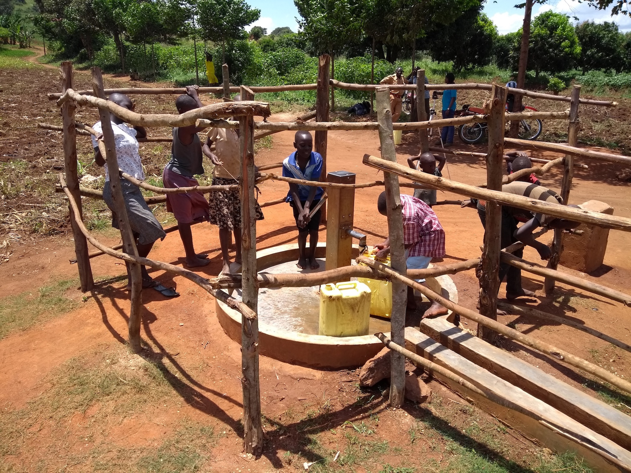 The Water Project : uganda6082-community-members-using-the-water-point
