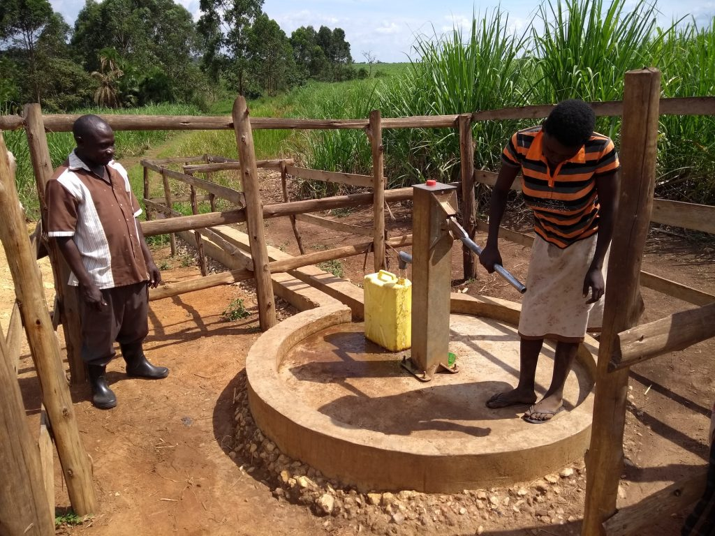 The Water Project : uganda6083-community-members-using-the-water-point
