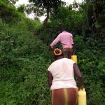 The Water Project: Ejinga-Ayikoru Community -  Carrying Water Back Home
