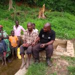 The Water Project: Ejinga-Ayikoru Community -  Field Officer Stephen With Community Members