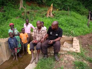 The Water Project:  Field Officer Stephen With Community Members