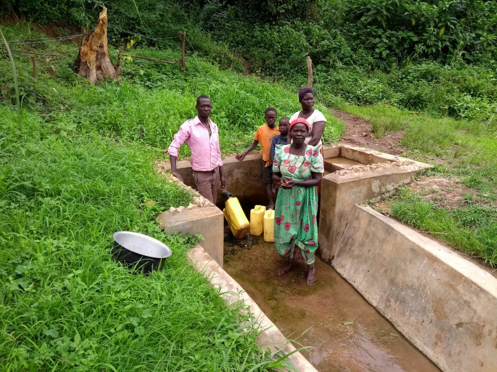 The Water Project : uganda6084-people-fetching-water