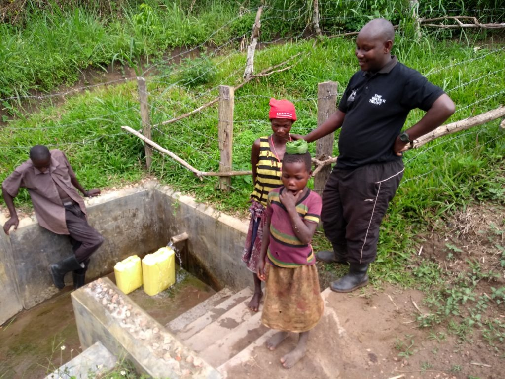 The Water Project : uganda6085-community-members-accessing-the-water-point