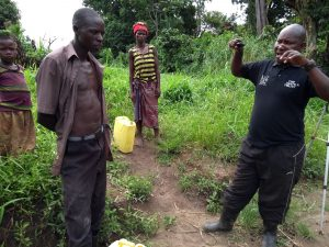 The Water Project:  Our Field Officer Making A Point To The Community Member