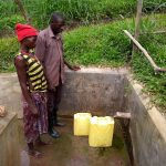 The Water Project: Abangi-Ndende Community -  People Fetching Water