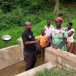 The Water Project: Katugo I-Alu Community -  A Field Officer Speaks With Community Members