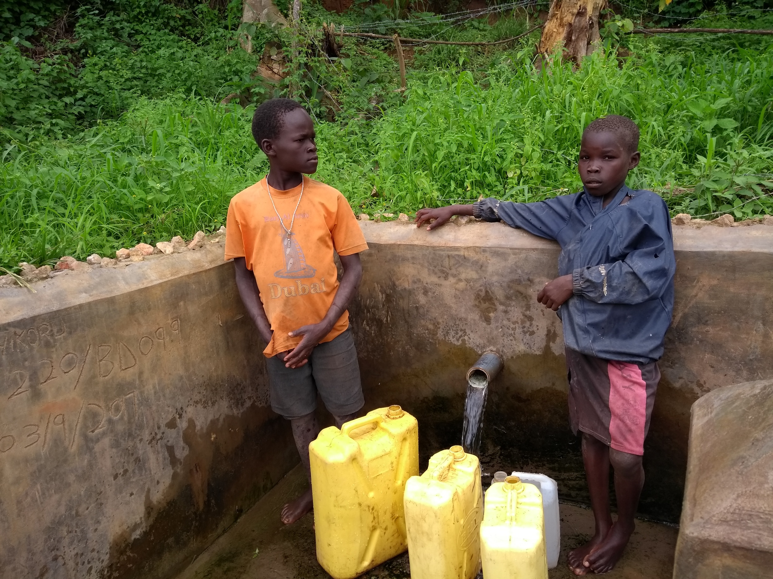 The Water Project : uganda6086-boys-collect-water-from-the-spring