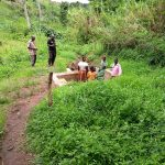 The Water Project: Katugo I-Alu Community -  People Gathered Around The Water Point