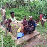 The Water Project: Karongo-Dum Community -  Mawwa Agnes Speaks With Out Field Officer At The Spring