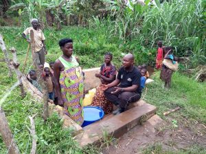 The Water Project:  Mawwa Agnes Speaks With Out Field Officer At The Spring