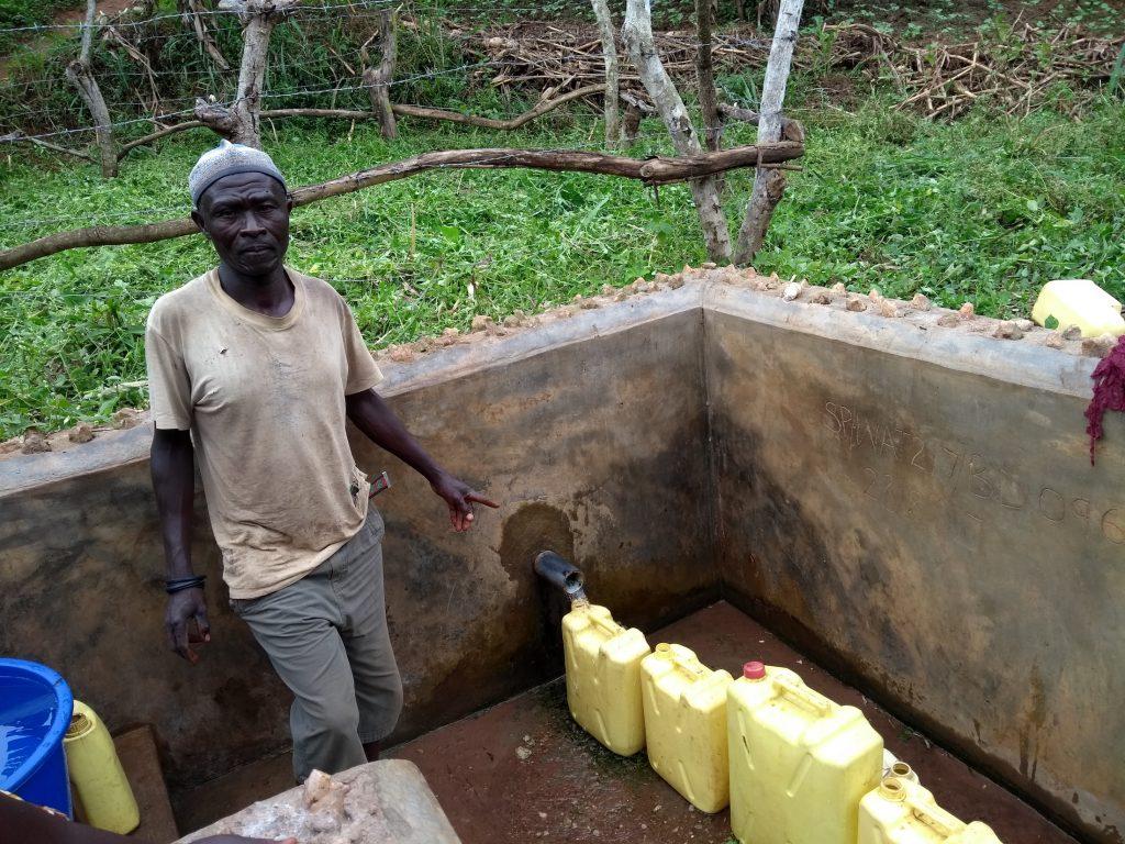 The Water Project : uganda6087-ochakire-muzamil-water-point-caretaker