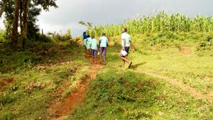 The Water Project:  Students Carrying Water Back