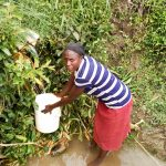 The Water Project: Musango Community, Emufutu Spring -  Fetching Water