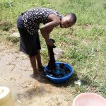 The Water Project: Musango Community, Mwichinga Spring -  Girl Doing Laundry At The Spring