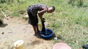 The Water Project:  Girl Doing Laundry At The Spring