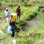 The Water Project: Musango Community, Mushikhulu Spring -  Carrying Water