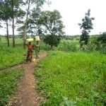 The Water Project: Karagalya Kawanga Community -  Carrying Water