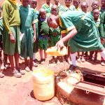 The Water Project: Sikhendu Primary School -  Fetching Water