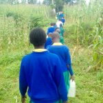 The Water Project: Koitabut Primary School -  Carrying Water Back
