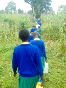 The Water Project:  Carrying Water Back