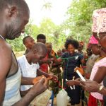 The Water Project: Roloko Community -  Making Handwashing Stations