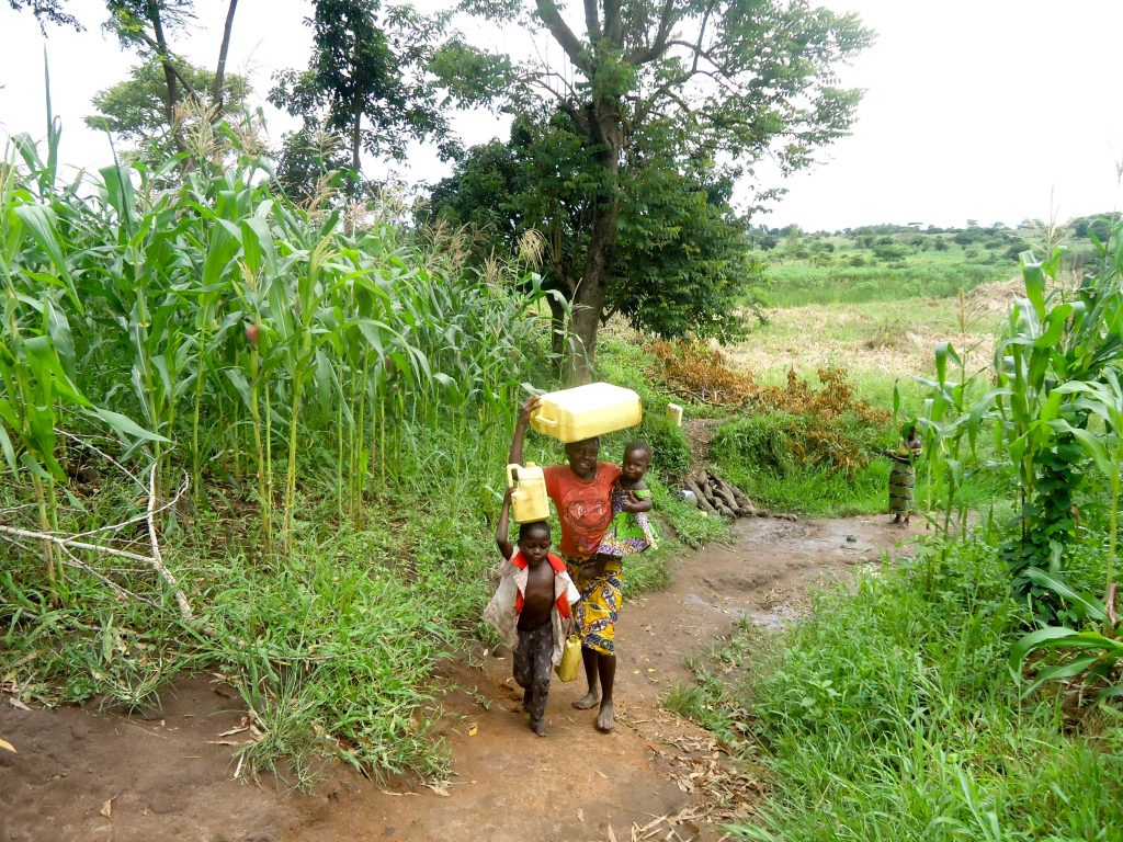 The Water Project : 11-uganda18302-carrying-water
