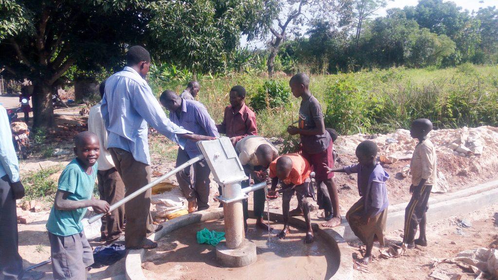The Water Project : 11-uganda18302-pump-installation