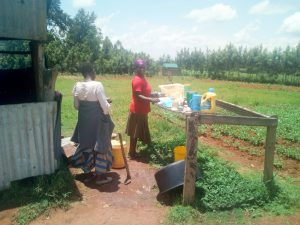 The Water Project:  School Cooks Drying Dishes