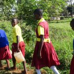The Water Project: Shibinga Primary School -  Carrying Water