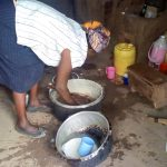The Water Project: Musango Primary School -  School Cook In Kitchen