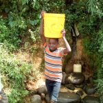 The Water Project: Musango Community, Mwichinga Spring -  Boy Fetching Water At The Spring