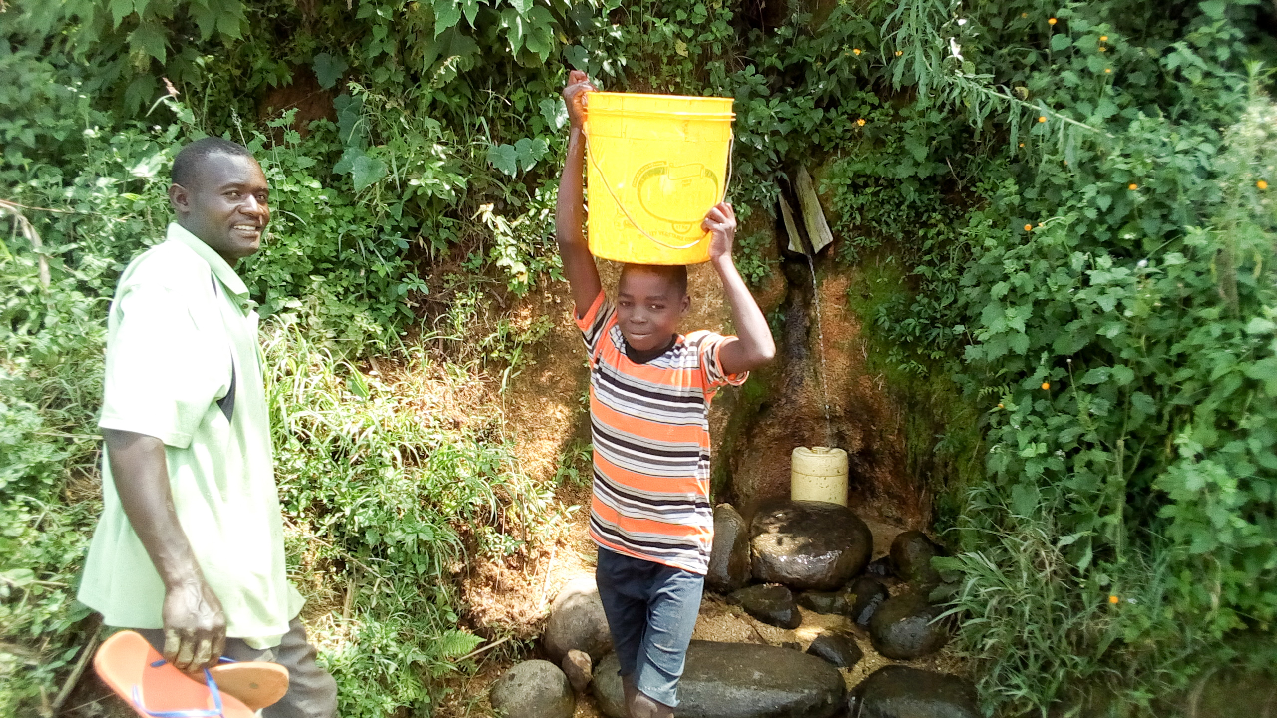 The Water Project : 13-kenya19104-boy-fetching-water-at-the-spring
