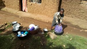 The Water Project:  Child Washing Utensils With Spring Water