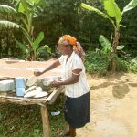 The Water Project: Musango Primary School -  School Cook At Dish Rack