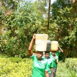 The Water Project: Chebunaywa Secondary School -  Carrying Water Back
