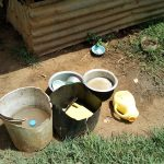 The Water Project: Musango Community, Emufutu Spring -  Water Containers Left Outside