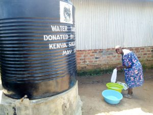 The Water Project:  Washing Clothes At A Plastic Tank