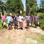 The Water Project: Namakoye Primary School -  Carrying Water Back To School