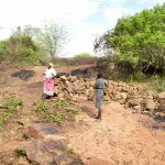 The Water Project: Kathamba Ngii Community -  Already Delivering Stones To The Potential Site