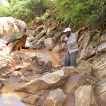 The Water Project: Ndithi Community -  Community Collecting Stones