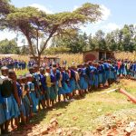 The Water Project: Sango Primary School -  Sudents In Bathroom Line