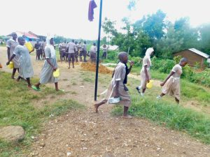 The Water Project:  Students Arriving At School With Water Containers