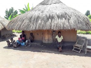 The Water Project:  Nyamungu Grace And Her Children Seated Outside Of Her Hut