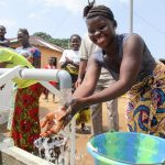 The Water Project: Modia Community, 63 Spur Road -  Clean Water Flowing