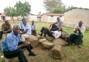 The Water Project:  Staff Sitting Outside