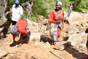 The Water Project:  Community Members Gathering Stones For More Water Points