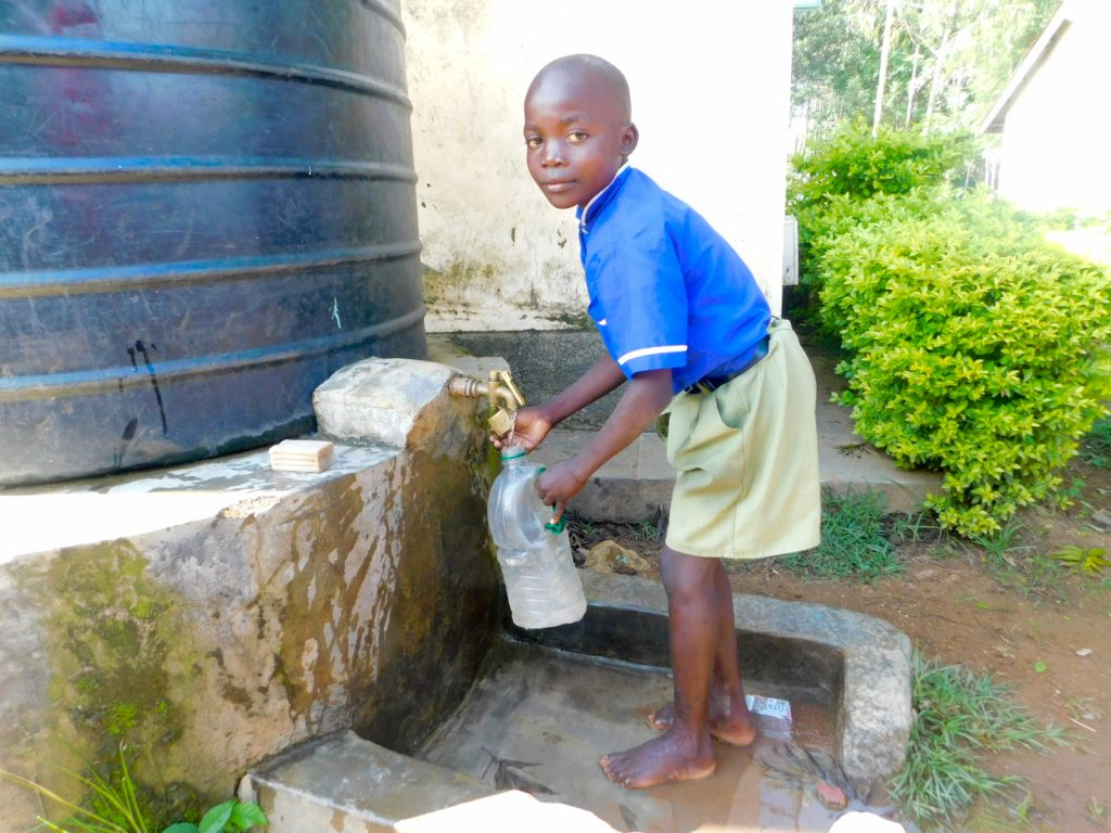 The Water Project : 4-kenya19171-1000-liter-plastic-tank-for-cooking-and-drinking