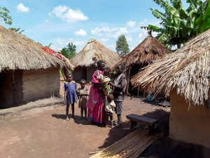 The Water Project:  Kandole Irene With Her Family At Their Home